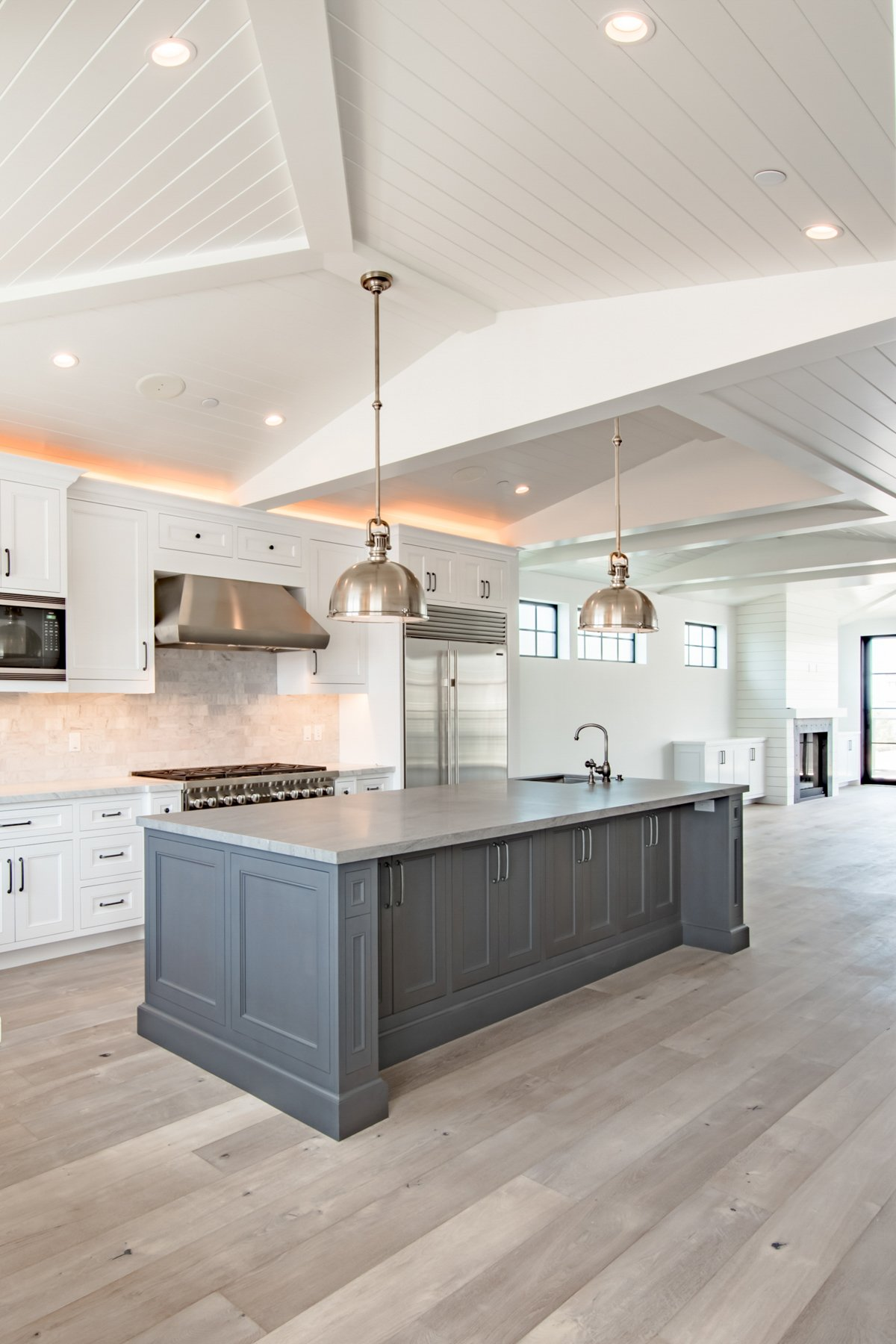 Newly built California beach house in farm house style white board and batten ceilings and open floor plan