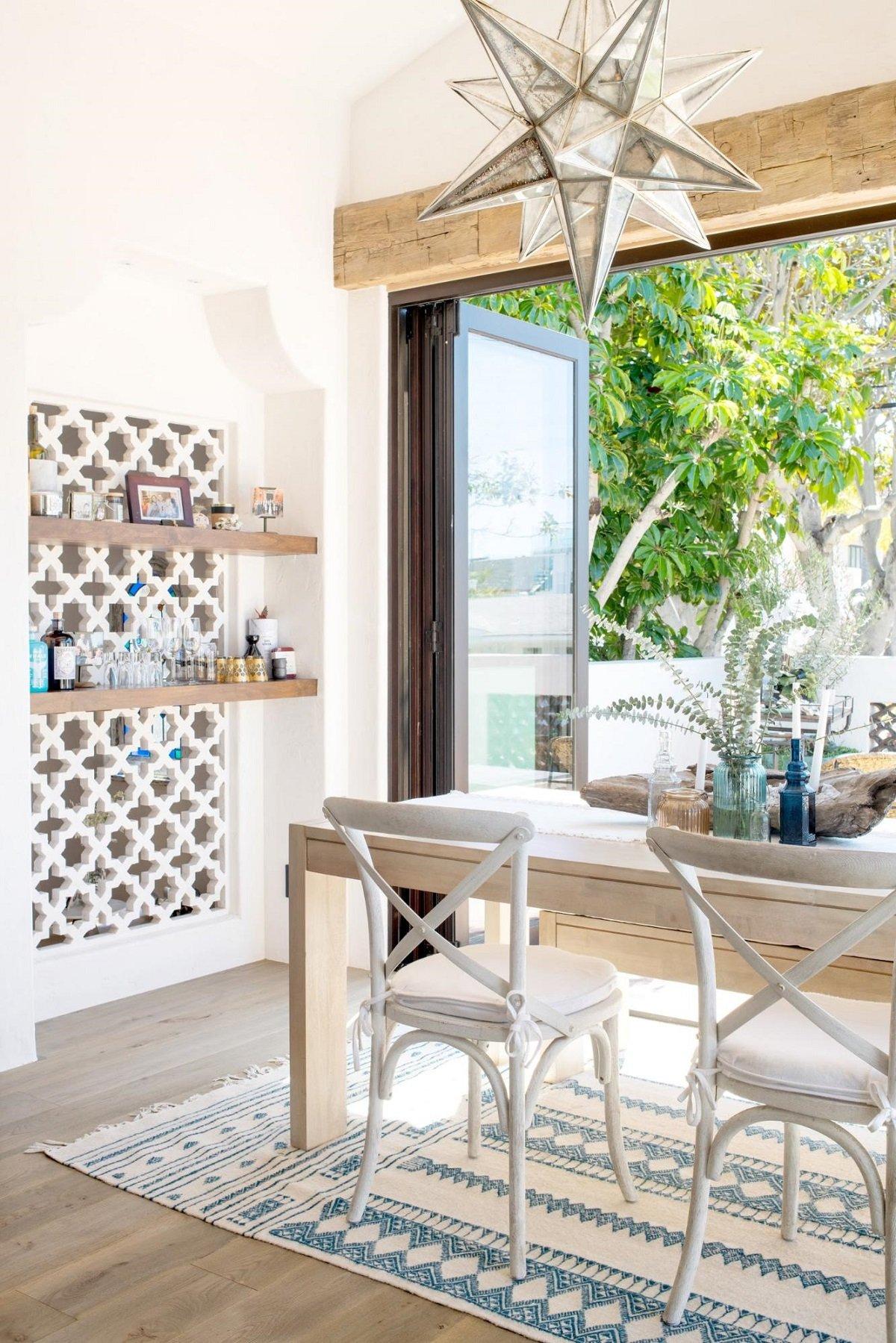 Floor to ceiling door in renovated Spanish bungalow kitchen