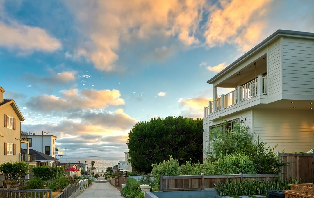Sunset view over California Beach House - Manhattan Beach walk street leading to the ocean lined by modern beach house