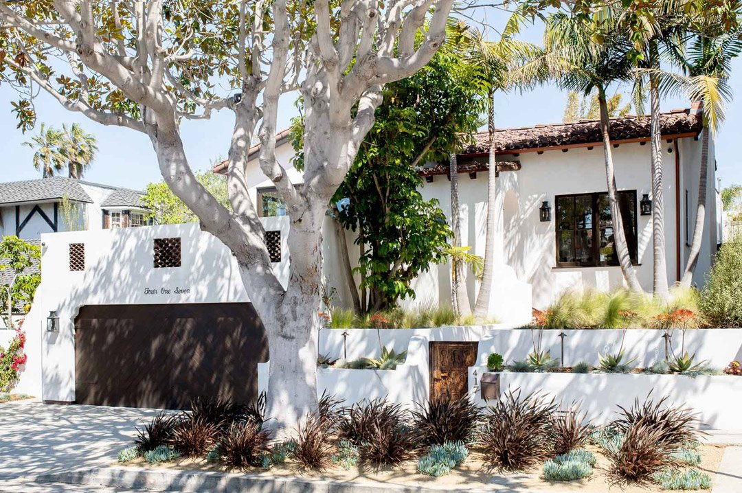 White renovated Spanish bungalow from the 1930s with red tile roofs